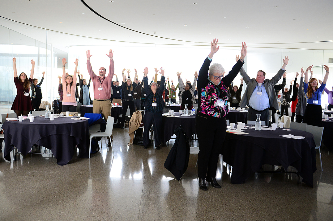 Conference participants take part in an exercise.