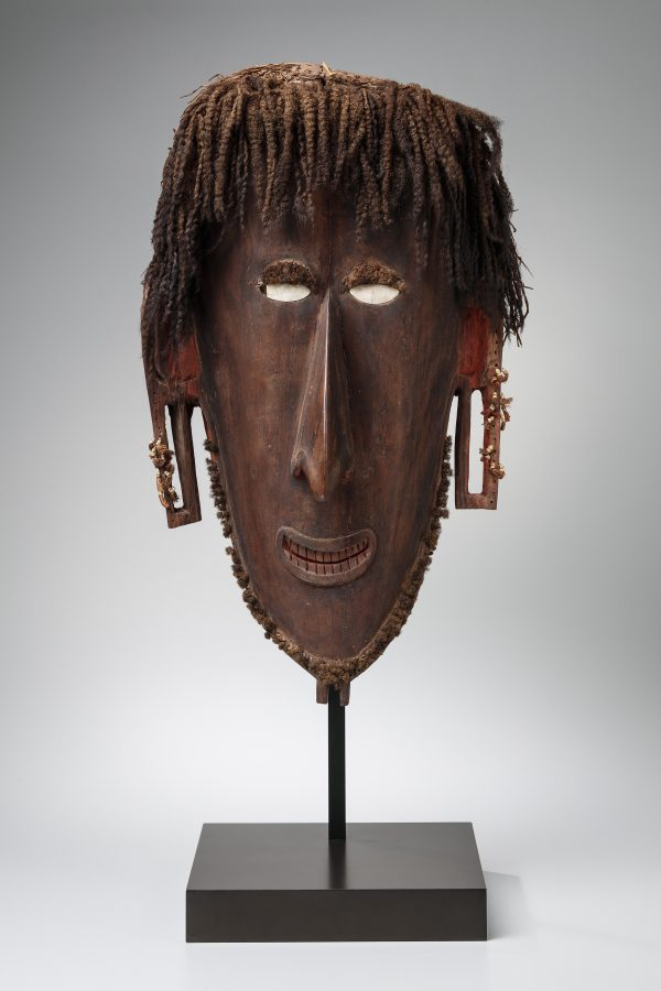 A large mask from the Torres Strait whic his located between Australia and New Guinea. The mask is made of wood, human hair, shell, seedpod, fiber, pigment, melo shell and coix seeds.