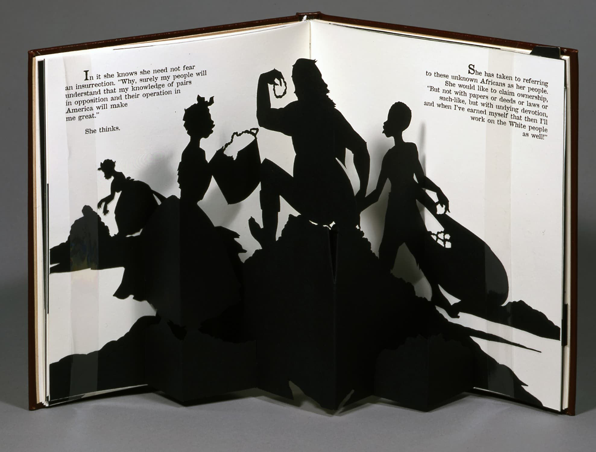 Freedom: A Fable Original paper designs: laser-cut black paper silhouettes, folded as pop-up elements