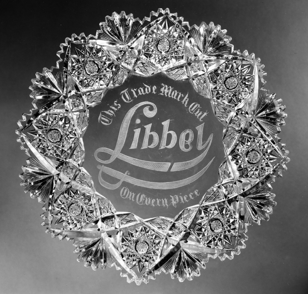 Libbey Glass Company, Toledo, Ohio, John Rufus Denman (American, 1876–1956) and Patrick H. Walker (American, 1868–1954), cutters, Plaque. Colorless glass, cut and engraved, 1903–1904. Diam. (rim) 12 3/16 in. (31 cm). Gift of Owens-Illinois Glass Company,