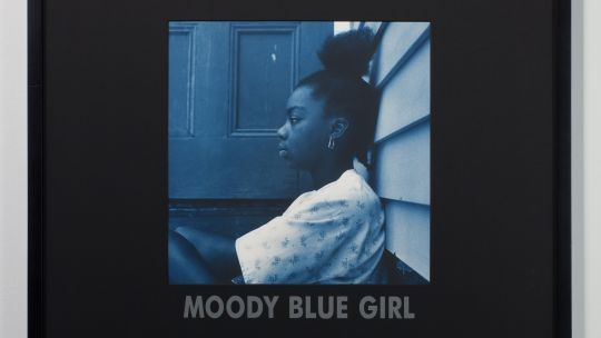Carrie Mae Weems, Moody Blue Girl, 1997. Gelatin silver print with text on mat, 30 x 30 in. Edition 4/5. Toledo Museum of Art, Purchased with funds from the Libbey Endowment, Gift of Edward Drummond Libbey, 2017.18