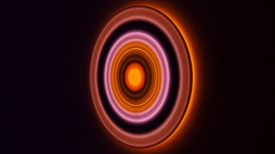 A series of orange and pink illuminated circles set against a black background