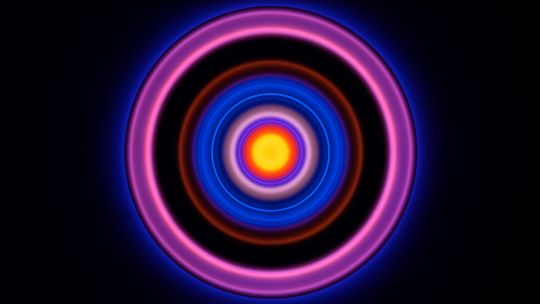 A series of red, purple and blue illuminated circles set against a black background