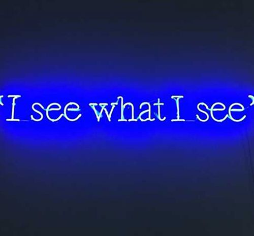 A bright blue neon sign that reads ''I see what I see""