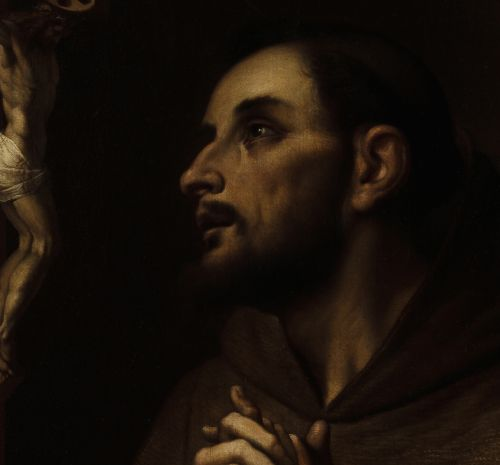 This is a painting of man with his hands clasped in prayer against his chest. He is looking up at a small crucifix. Below the crucifix sits a human skull sits on top of tree trunk.