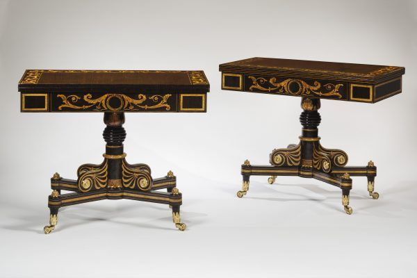 A pair of wooden card tables made of Mahogany, maple, pine, and poplar, painted and paint-grained rosewood, and gilded, with gilt-brass toe caps and castors and die-stamped rosettes, and red velvet in the wells.