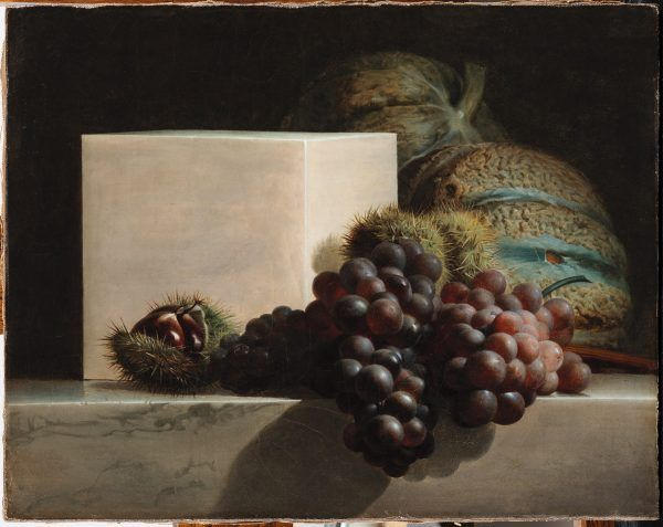 In this painting, a group of dark purple grapes sits in front of a bright white marble cube. In the background are large green and tan melons. Spike chestnuts sit behind the grapes and the melons.