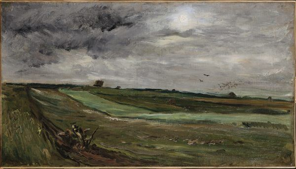 A green field stretches across the landscape while the sky is various shades of gray. A man with a plough is working the field while small buildings and a flock of birds are in the background.