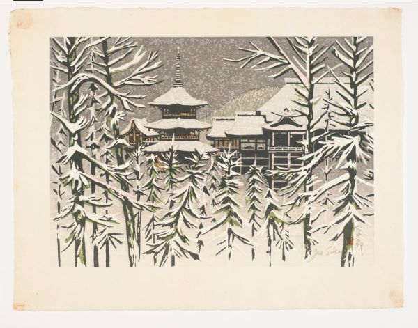 A pine forest is covered covered in snow. In the background is a Japanese temple.