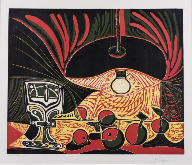An image of a linocut prinshows a brightly illuminated group of apples next to a glass goblet displayed under an electric lamp. Its decorative design comprised of flattened objects, and vivid yellow and red sweeping contour lines that cut through the dark