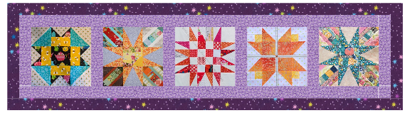 Five quilt squares are stitched together in a single row and are surrounded by a light and dark purple fabric border.